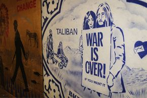 Graffiti artist Banksy updates John Lennon and Yoko Ono's 1969 Vietnam War protest to tackle modern armed conflict.