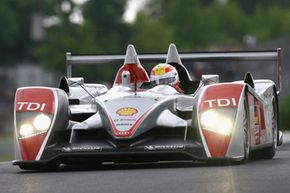 The Audi of Rinaldo Capello of Italy, Allan McNish of Great Britain and Tom Kristensen competes during the Le Mans 24 Hour race at the Circuit des 24 Heures du Mans on June 16, 2007 in Le Mans, France.