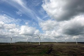 Wind-powered turbine sails in the U.K. Scout Moor Wind Farm started supplying power to the national grid June 30, 2008. The controversial project will dominate the local skyline, but will also be able to power 30,000 homes.