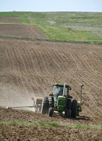A farmer plants corn in Iowa. Many farmers have decided to grow corn instead of other crops because of an increased demand from ethanol producing plants.