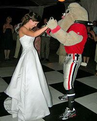 Bride Ryan Johnson dances with the University of Georgia's Hairy Dawg mascot at her reception.