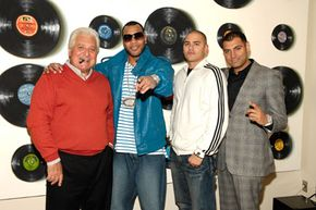 Attorneys may negotiate contracts for musicians. Here shown from left, Sony ATV CEO Martin Bandier, rap artist Flo Rida, AVP Sony Music Publishing Juan Madrid and attorney Sandy Lal celebrate Flo Rida's signing.