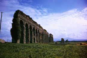 Ruins of the Claudian Aqueduct, built in 313 B.C.E., near Rome, Italy.