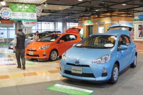 Toyota's Prius was the first hybrid car commercially available. Here, Toyota shows off the Aqua -- a hybrid gasoline-electric subcompact hatchback -- at the company's show room in Tokyo on May 8, 2013.