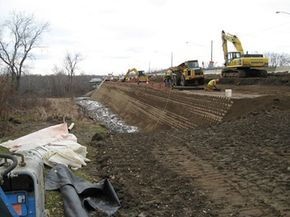 A retaining wall is reinforced with EnviroGrid.