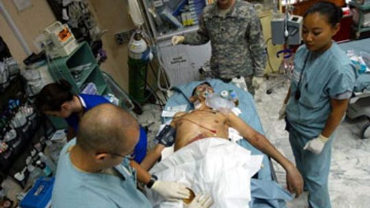 What equipment do Army combat surgeons have?