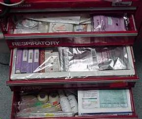 Select contents of an ER crash cart you might find by a patient's bedside.