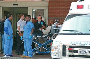 A man is wheeled into the Emergency Room (ER) of Boston Medical Center following the explosions near the finish line of the Boston Marathon in 2014. ERs do disaster drills to prepare for situations like this.
