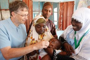 Bill Gates, co-chair of the Bill and Melinda Gates Foundation, immunizes Ishaka Bashiru against polio at Bini Community Health Post in Nigeria. See more staying healthy pictures.