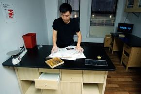 Kevin Cheng, one of the founders of Mystery Room in New York, prepares the venue for clue-solvers.