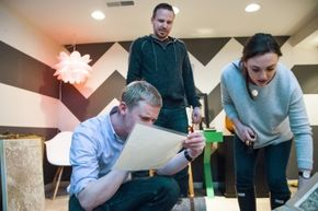 Clue-solvers try to think their way out of a Washington, D.C., escape room game.