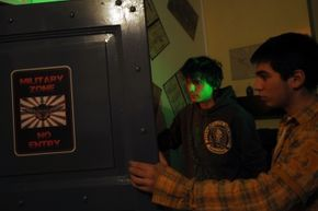 Players search for clues in a military-themed Serbian escape room.