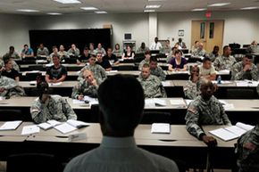 North Carolina Employment Security Commission official Thomas Snuffer delivers a lecture on the civilian workplace to a group of soldiers at Fort Bragg, N.C.