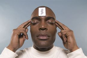 Man trying to guess card on his forehead