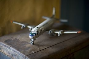Some items can be worth a surprising amount of money, such as this vintage toy plane and antique trunk. Don't get rid of anything until an expert looks through the home.