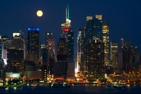 An aerial shot of a skyline, like this one of midtown Manhattan, can help establish time of day, season and setting.