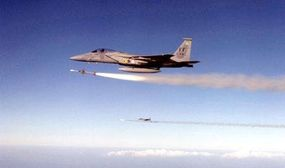 Two F-15s launch AIM-7 Sparrow air-to-air missiles in training exercises.