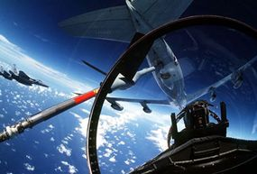 The F-15 bubble canopy gives the crew a wide view of the sky. This plane is preparing to refuel.