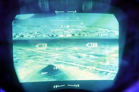 An infrared terrain image displayed on an F-15's heads-up display