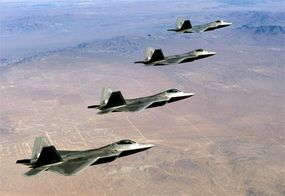 Four F/A-22 Raptors fly over the Mojave Desert during a landmark test mission.