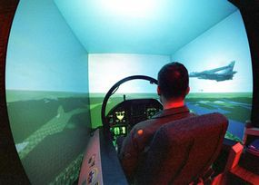A Naval Aviator trains on an F/A-18 Flight Simulator. The F/A-18 is known for being relatively easy to learn to fly.