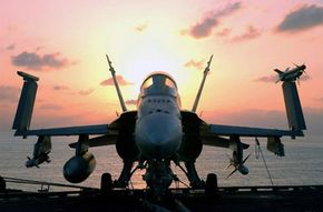 An F/A-18 sits on the flight deck of an aircraft carrier in the Persian Gulf.