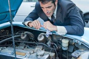 Man peering at engine