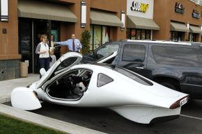 The Aptera 2e takes a break from being aerodynamic to grab some coffee at Starbucks. Aptera Motors eventually folded in December 2011.