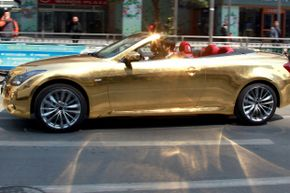 While all of the cars you drive may not be as flashy as this gold-plated sports car, your need for speed and lavish autos will definitely be satisfied as a luxury car test driver.