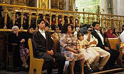 The quinceañera will select 15 people, often including close family members, to carry candles.