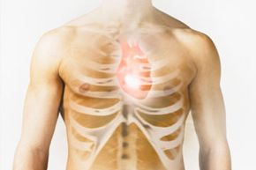 Man with heart and ribs image over chest, close-up (Digital Composite)
