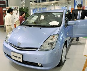 Economic theory says that as the supply of Priuses becomes more abundant (like the 2008 model shown in a Tokyo showroom), the costs associated with repairing its uncommon transmission should decrease.