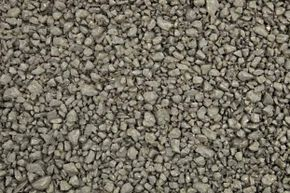 The larger aggregate and lack of sand in pervious asphalt (shown here) creates interconnected voids, allowing water to flow through the surface rather than off it, which reduces stormwater runoff.