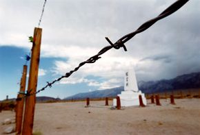 Barbed wire surrounds the cemetery of the Manzanar War Relocation Center, where 10,000 Japanese-American citizens and Japanese aliens were interned during World War II after the bombing of Pearl Harbor.