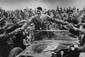 Master of the Big Lie, Adolf Hitler is welcomed by supporters at Nuremberg.