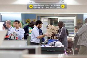 A man is screened during a security check at Ben-Gurion Airport in Israel.  Israeli airport security officials are famous for the techniques they use to question passengers before a flight.