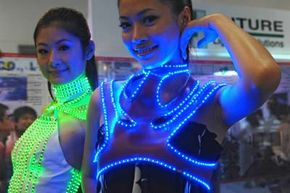 Two Taiwanese models wear LED costumes at a photonics festival in Taipei. Learn more with pictures of essential gadgets.