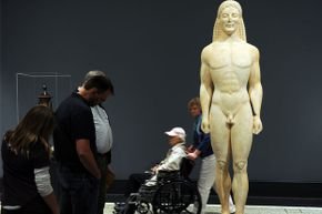 Visitors look at the possibly fake statue at the Getty Villa Museum in Malibu, Calif. on April 18, 2011.
