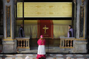 The Shroud of Turin on display in the Turin Cathedral on March 30, 2013. While the authenticity of the shroud is still debated, the relic still holds religious significance for many Catholics.