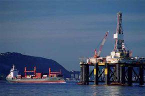 A freighter passes an oil drilling platform in Guanabara Bay, Rio de Janeiro, Brazil.