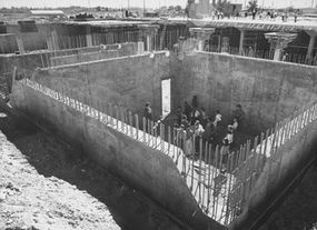 Construction of combined underground school and fallout shelter.