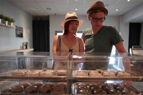 Ali Leopold (L) and Andrew Herrold choose faux donuts at Fonuts bakery, which offers gluten-free and vegan donuts, in Los Angeles. Even people who are not gluten-intolerant have been trying the gluten-free diet for health reasons. But should they? See pictures of healthy food.