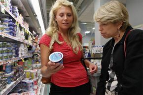 Dietician Jennifer Shea (L) from Shaw's/Star Market and Nora Saul, nutrition manager from Joslin Diabetes Center, look at the ingredients in yogurt at the store's location in Cambridge, Mass. Sometimes fat-free doesn't mean less calories.