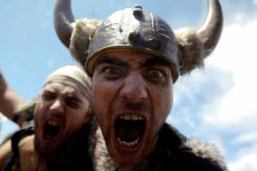 Men dressed up (rather inaccurately) as Vikings take part in the annual Viking festival of Catoira in north-western Spain.
