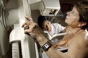 Grace Lee, M.R.T. (R) performs a mammogram on Sharon Panke, at the Ontario Breast Screening Program in Toronto, 2005.