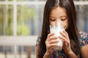 Is drinking milk going to make her taller? Not necessarily.