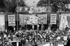Over the years, sideshows have drawn large crowds, like this one in the 1950s.