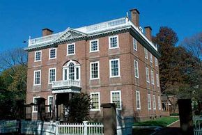 """© Providence Warwick Convention and Visitors Bureau.                                  A three-story 18th-century redbrick with white trim is representative of the                                                  famously restored structures on the """"Mile of History."""""""