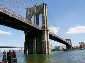 Amazing Bridges Image Gallery The Brooklyn Bridge, designed by architect John Augustus Roebling, towers over New York City's East River. See more pictures of amazing bridges.