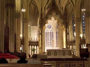 Stained glass windows surround the altar at St. Patrick's Cathedral.